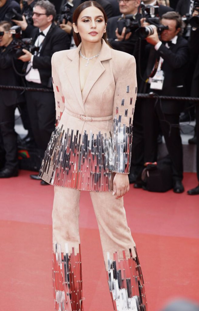 Huma Qureshi, who is making her debut appearance on the Cannes red carpet, ditched the gown and opted for a beige pantsuit