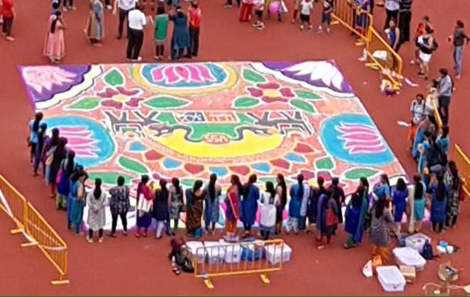 VSS received a certificate from Singapore book of records for the largest Rangoli made of Sogo during the ITGF-2018 event.