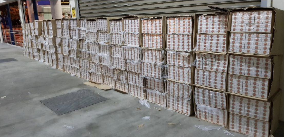6,000 cartons of duty-unpaid cigarettes were uncovered in a prime mover on 18 May at Tuas checkpoint. Photo courtesy: ICA