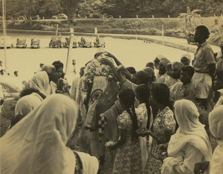 The love for Mahatma Gandhi among Singaporean people was so much that considerable number of them turned up and touched the urn containing  Mahatma's ashes near Clifford Pier in Singapore.