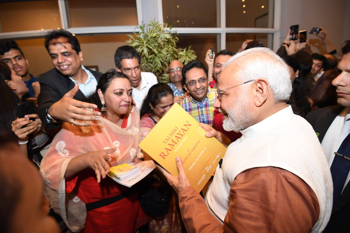 One of the members of Indian community presenting Valmiki Ramayana to the Indian Prime Minister Narendra Modi in Jakarta. Photo courtesy: Twitter page of PM Narendra Modi