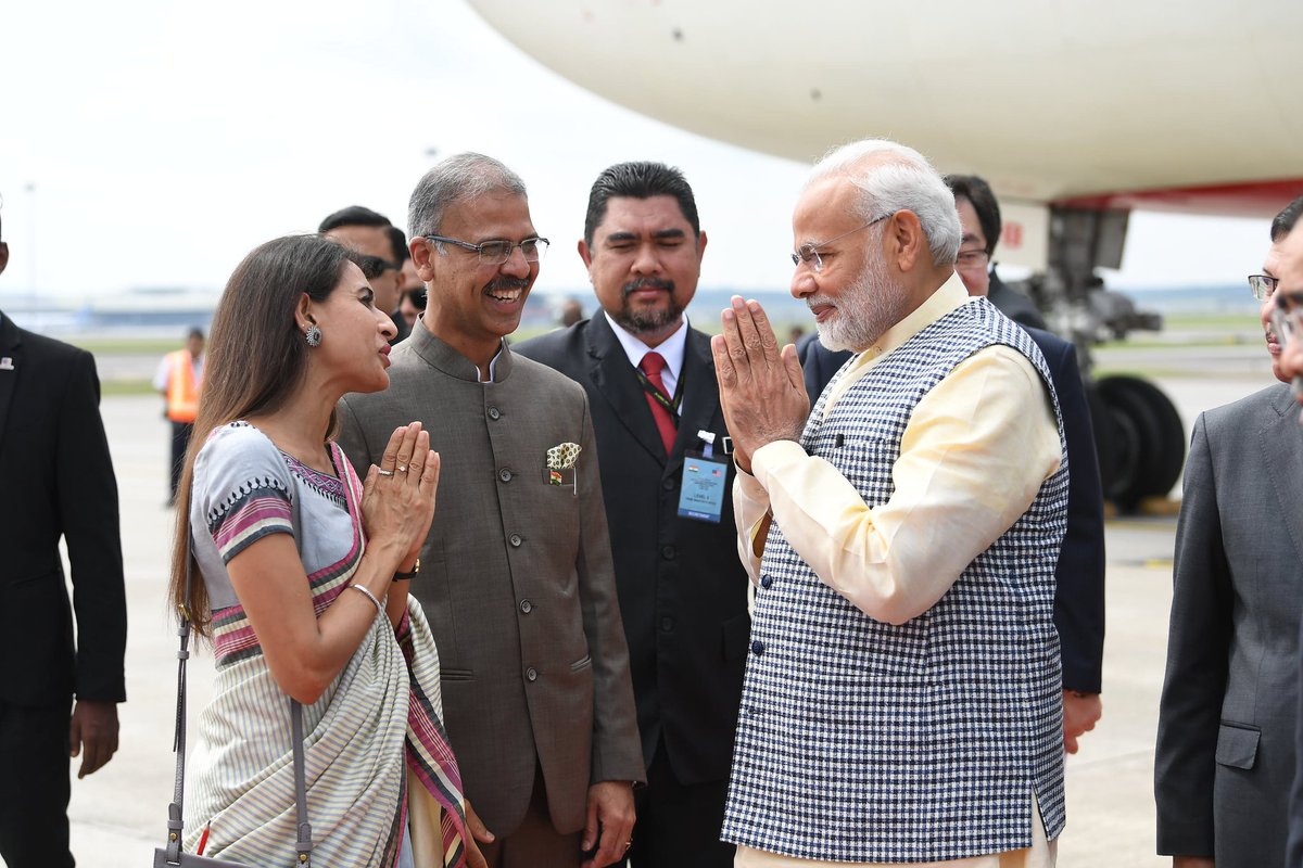 PM Modi being welcomed by Indian officials as he lands in Kuala Lumpur.