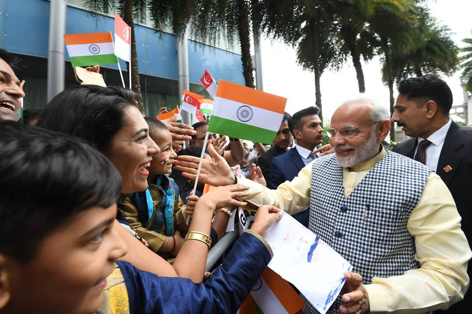 People belonging to Indian community enthusiastically welcomed Indian Prime Minister Narendra Modi on his arrival in Singapore.