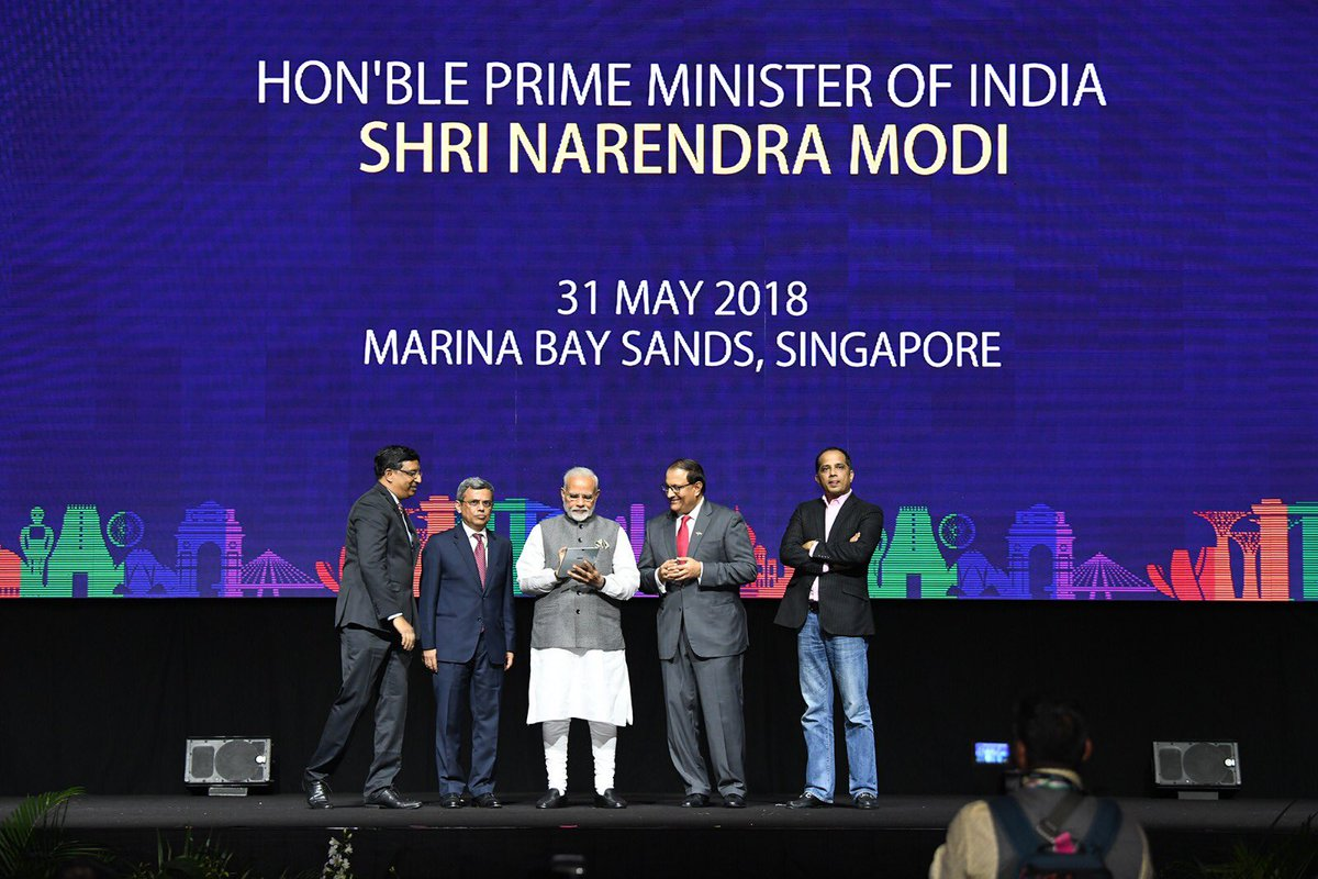 PM Modi launching RuPay, Bhim App and UPI enabled remittance app in Singapore. Photo courtesy: Twitter/@MEAIndia