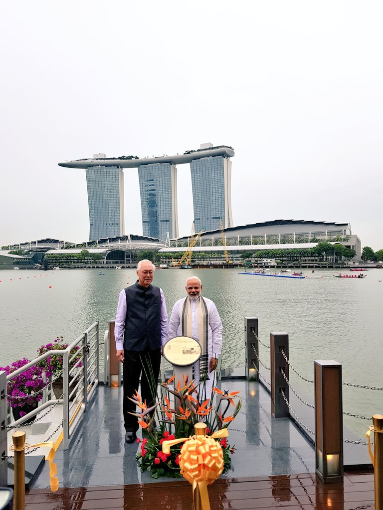 Indian Prime Minister Narendra Modi along with former Prime Minister of Singapore, ESM Goh Chok Tong at the immersion site of Mahatma Gandhi's ashes at Clifford Pier in Singapore.