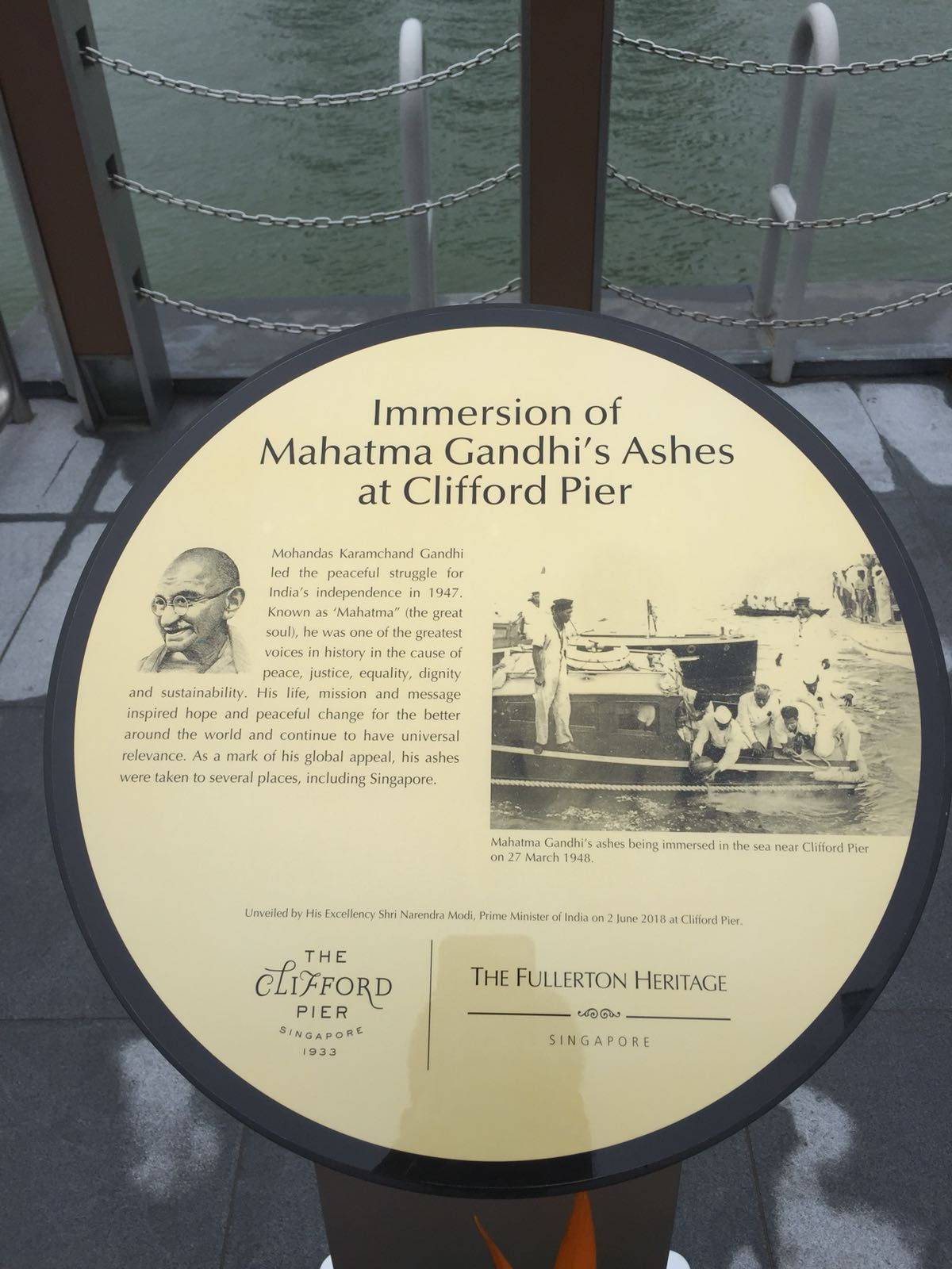 The board containing the details about the immersion of Mahatma Gandhi's ashes at Clifford Pier in Singapore.