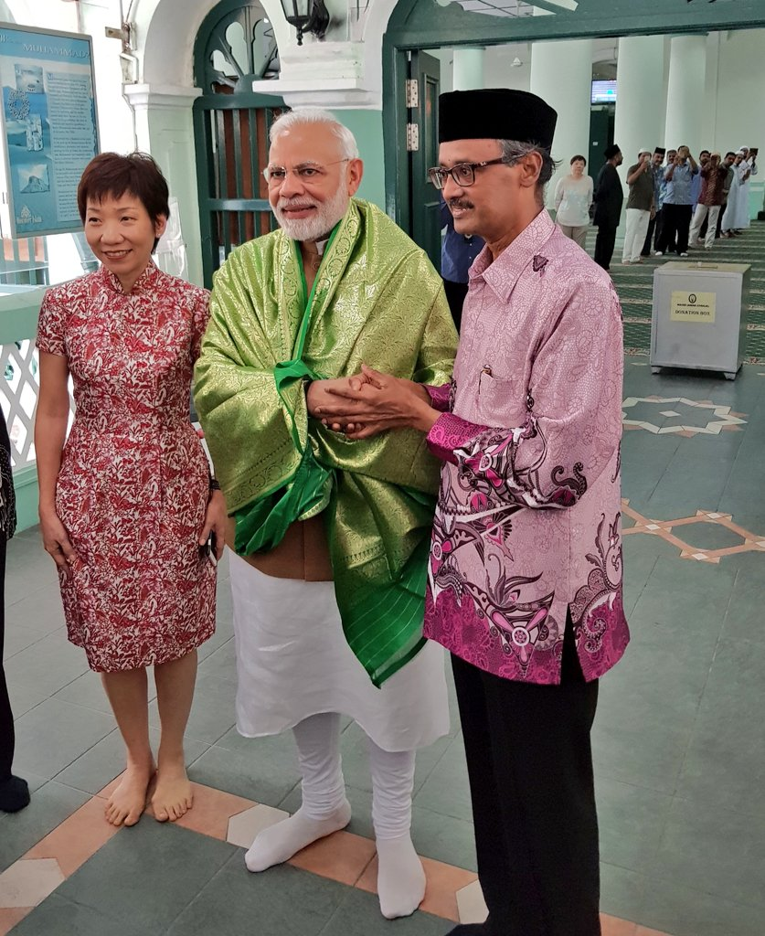 PM Modi visiting Chulia mosque in Singapore. He is accompanied by Singapore Culture Minister Grace Fu Hai Yien. Photo courtesy: Twitter/@MEAIndia