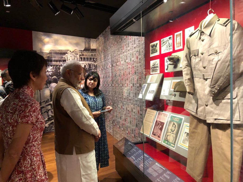 PM Modi seeing various exhibits being displayed at the Indian Heritage Centre.