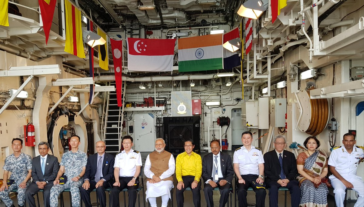 PM Modi, Senior Minister of State for Defence of Singapore Md. Maliki Osman and other dignitaries on-board the RSS Formidable Frigate of the Singapore Navy. Photo courtesy: Twitter/@MEAIndia
