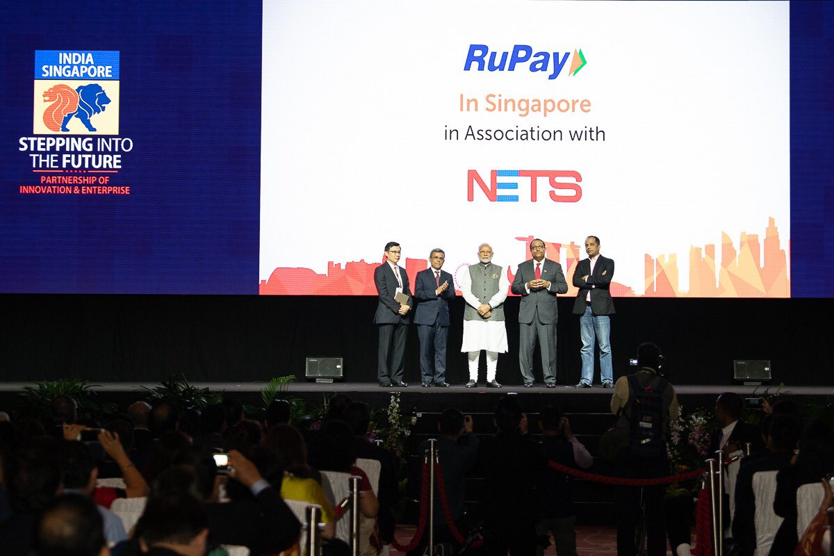 Indian Prime Minister Narendra Modi (third from left) inaugurating the RuPay-NETS payment scheme during his recent visit to Singapore. S Iswaran, Singapore's Minister for Trade and Industry (fourth from left) and HE Jawed Ashraf, Indian High Commissioner to Singapore (second from left) are also present on the occasion.