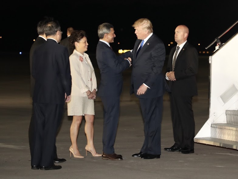 Singapore's Foreign Affairs Minister Dr Vivian Balakrishnan welcoming US President Donald Trump at the Paya Lebar Base as the latter arrives in Singapore to participate in historic summit meeting with North Korean leader Kim Jong Un. Photo courtesy: Ministry of Communications and Information