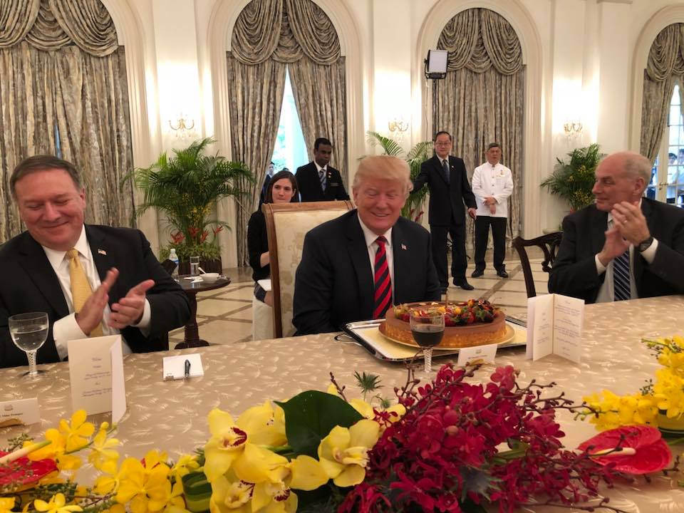 President  Trump, who turns 72 on June 14, being presented with a birthday cake during the working lunch while Secretary of State Mike Pompeo and Chief Of Staff John Kelly look on.
