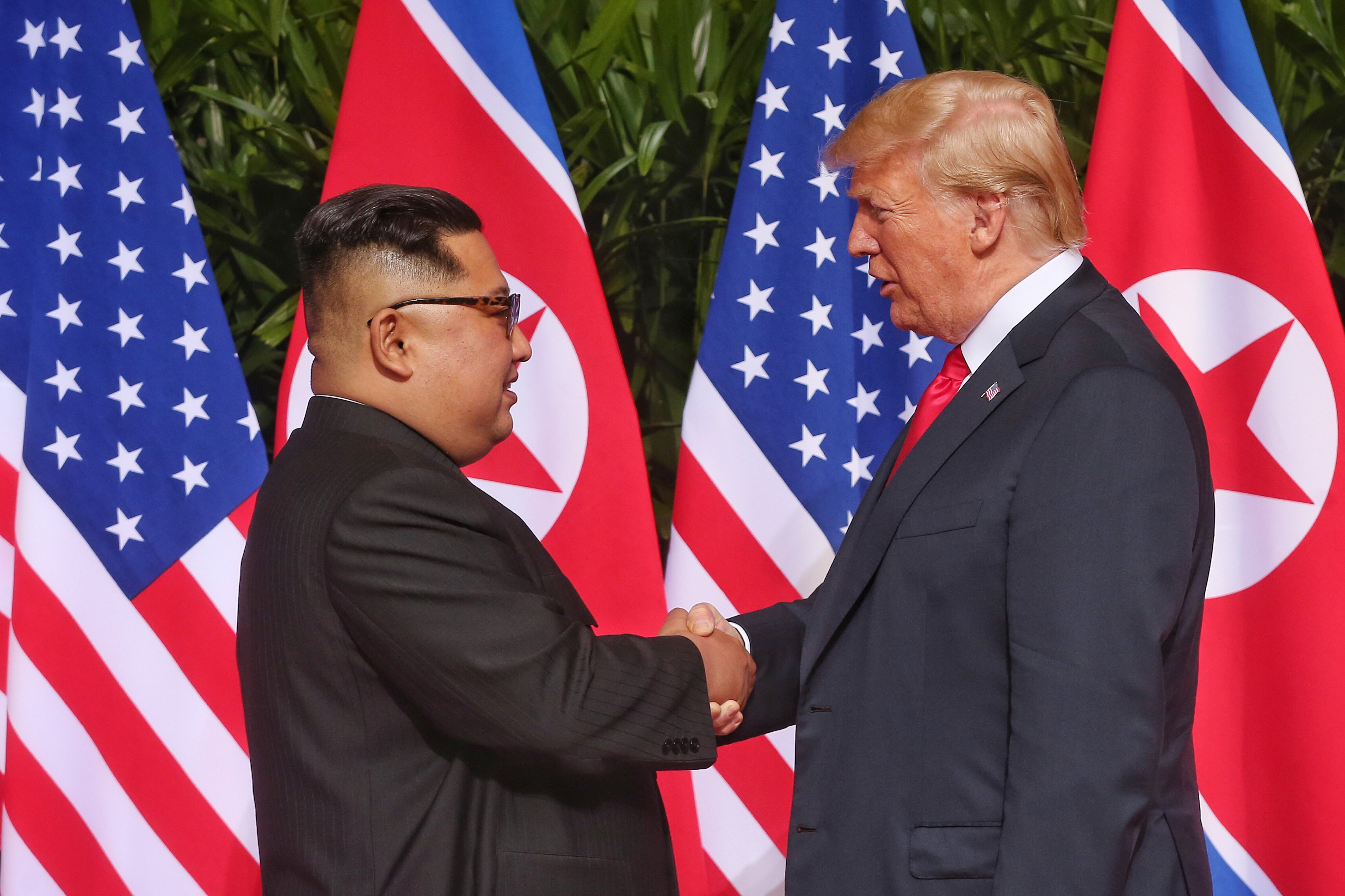 US President Donald Trump and North Korean leader Kim Jong Un shake hands in front of the world's media as DPRK-USA Singapore Summit started today.