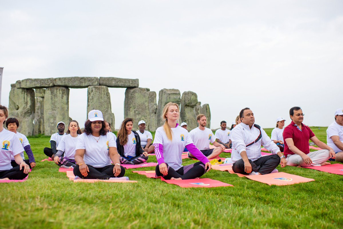 A yoga session being held at the Stonehenge heritage site to mark IDY 2018.