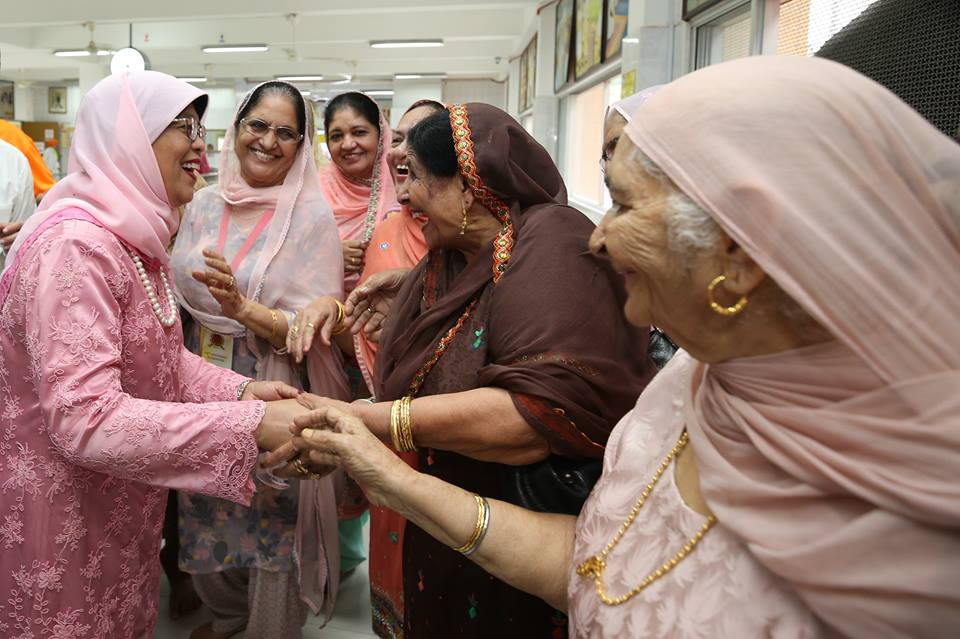 President of Singapore Halimah Yacob interacting with women of Sikh community during centenary celebrations of Gurdwara Sri Guru Singh Sabha(SGSS) in Singapore.