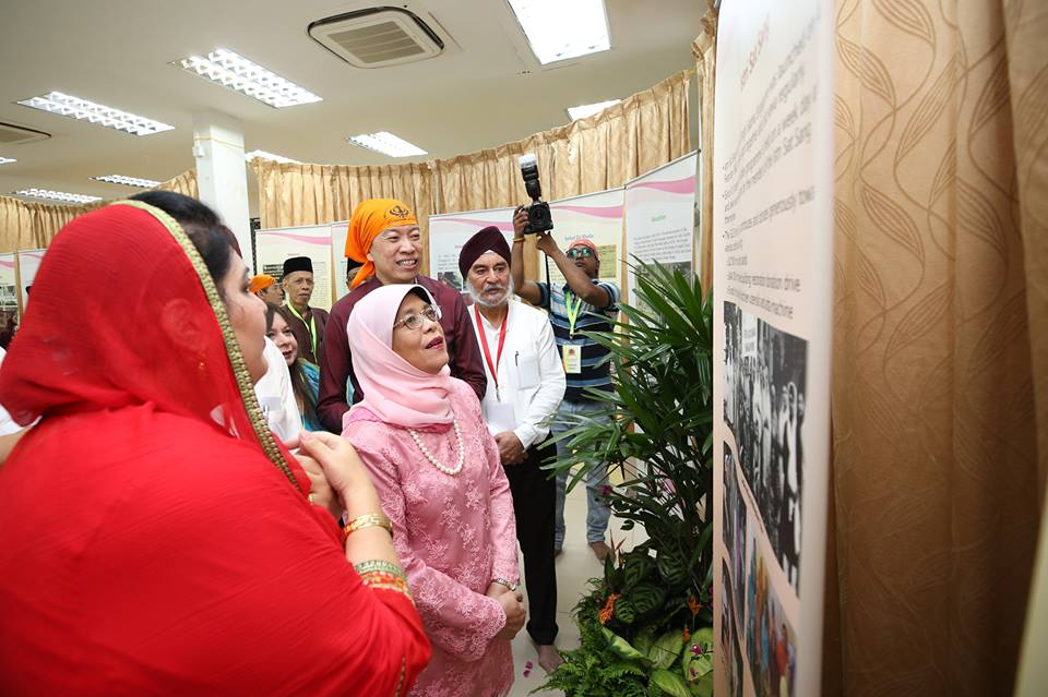 President of Singapore Halimah Yacob seeing the exhibition on the history of SGSS.
