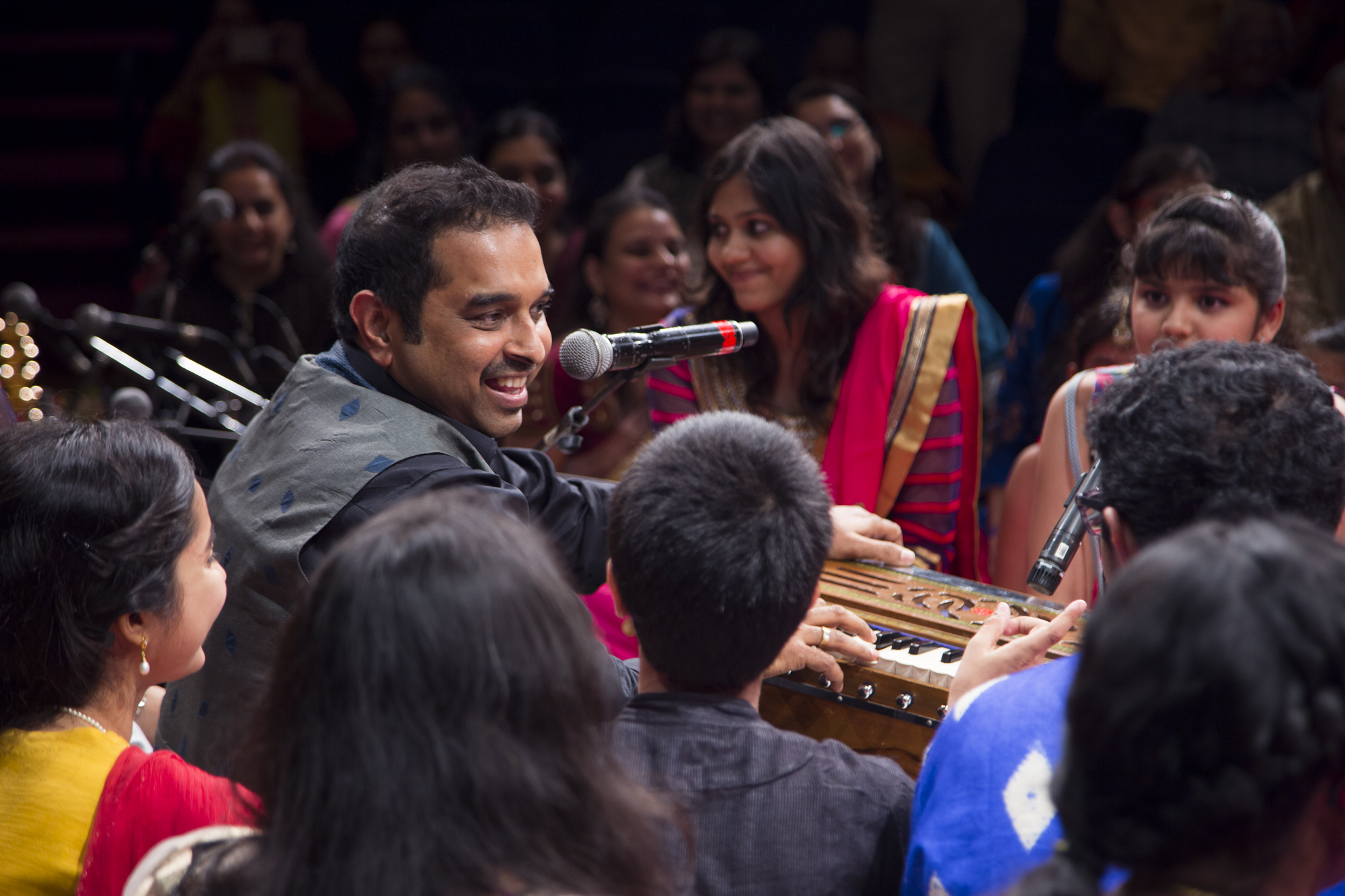 Shankar Mahadevan imparting music lessons to young children.