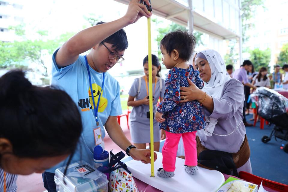 Height of a child being measured at a community health and developmental screening event at Boon Lay in Singapore. Photo courtesy: Facebook page of Minister Desmond Lee