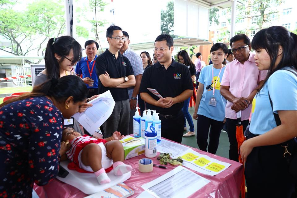 A child being examined at the health screening event in presence of Desmond Lee, Social and Family Development Minister of Singapore. Photo courtesy: Facebook page of Minister Desmond Lee