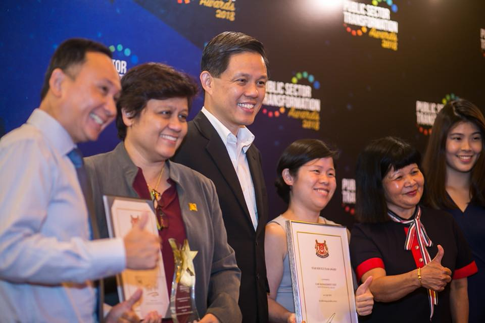 Chan Chun Sing along with winners at the Public-Sector Transformation Awards ceremony.