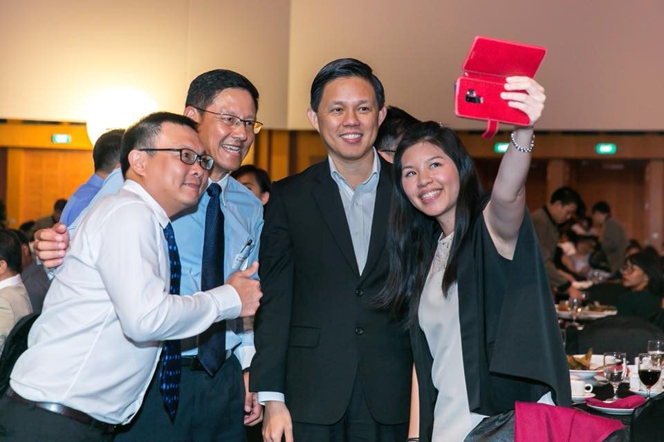 One of the attendees at the ceremony taking a selfie along with Minister-in-charge of Public Service Chan Chun Sing. Photo courtesy: Facebook page of Chan Chun Sing