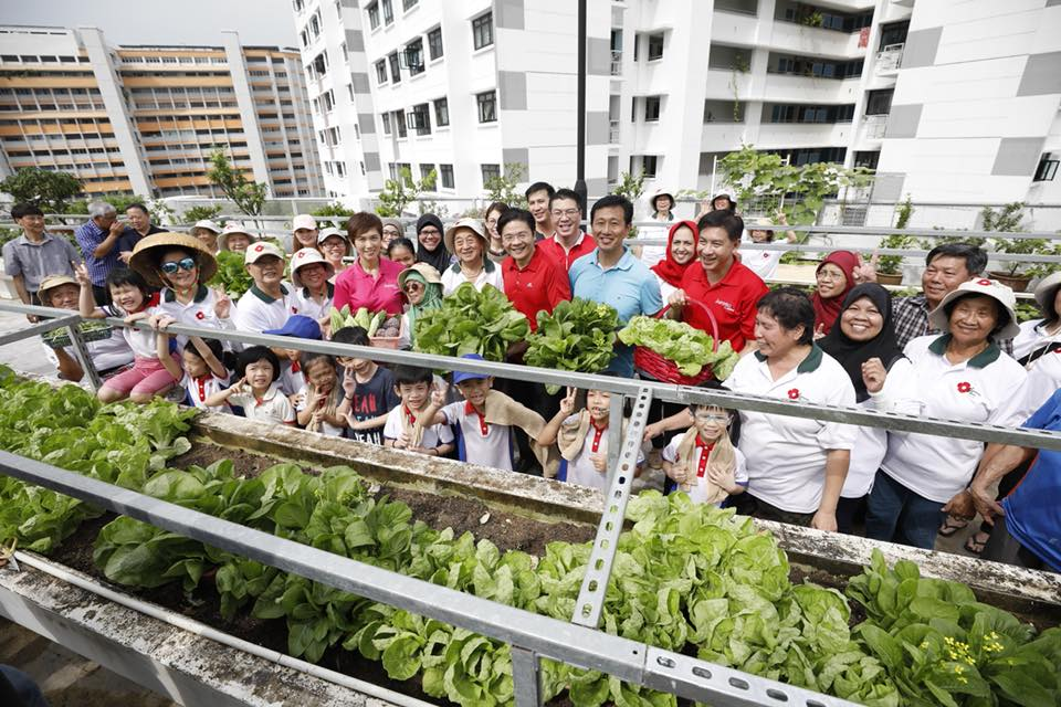 Ong Ye Kung, Education Minister, Josephine Teo, Manpower Minister and Lawrence Wong, National Development Minister along with the residents and children at Jurong Central Sky Garden. Photo courtesy: Facebook page of Minister Josephine Teo