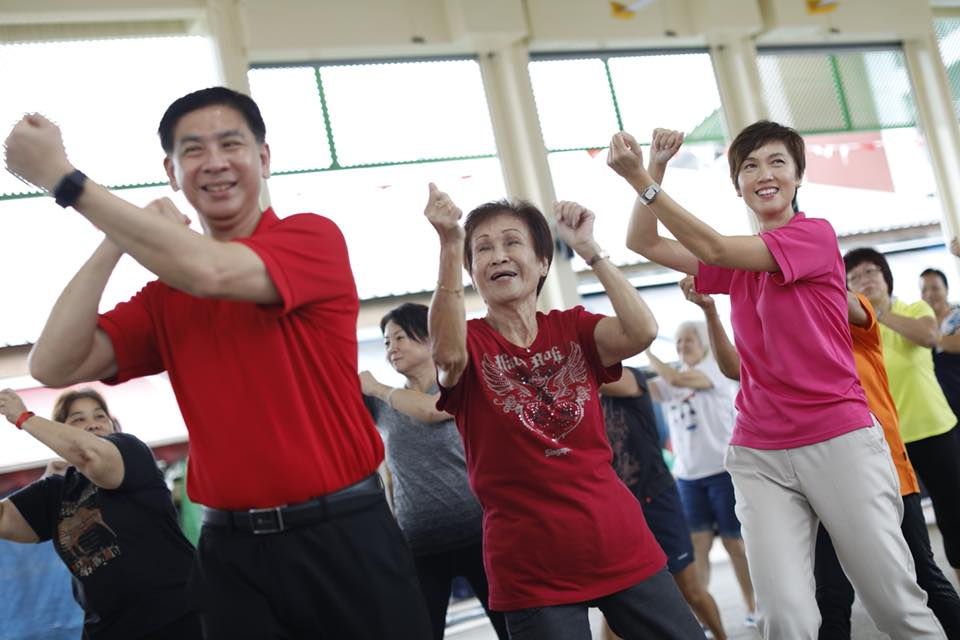 Josephine Teo, Manpower Minister of Singapore(right) performing exercise with an elderly citizen during her interaction with residents of Jurong Central Division. Photo courtesy: Facebook page of Minister Josephine Teo