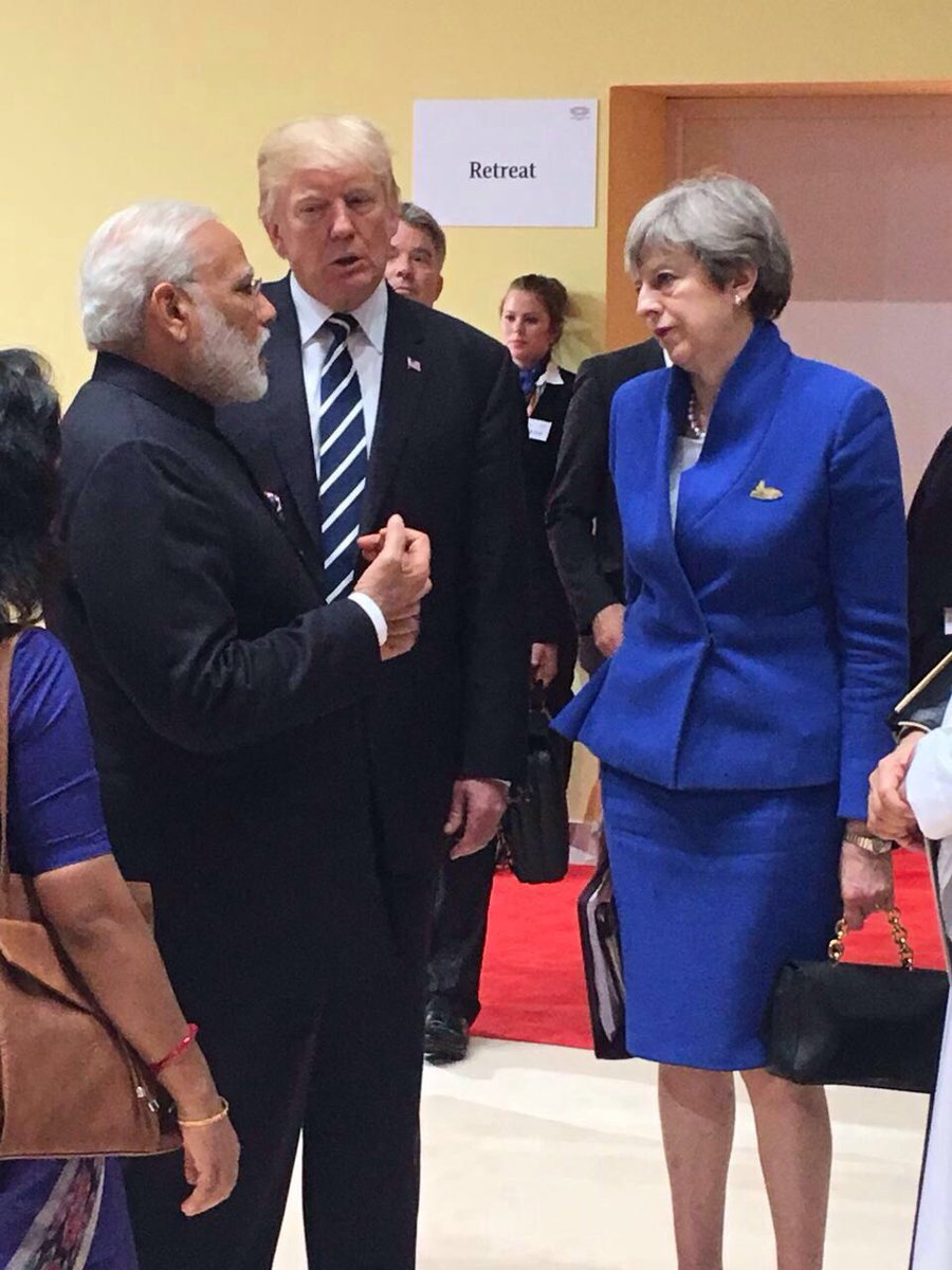 Indian PM Narendra Modi (left) and US President Donald Trump (centre) with UK PM Theresa May at the G20 Summit. Photo courtesy: MEA