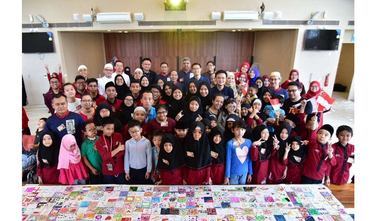 Students,Club Rainbow beneficiaries and their caregivers at the Coaster Magnet Design Workshop. Photo courtesy: MUIS