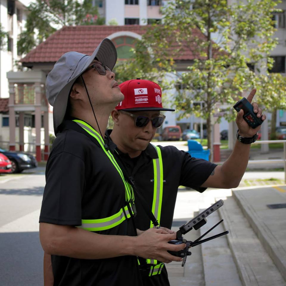 Personnel of Performance Rotors operating drones at HDB block in Jurong East. Photo courtesy: Facebook page of Performance Rotors