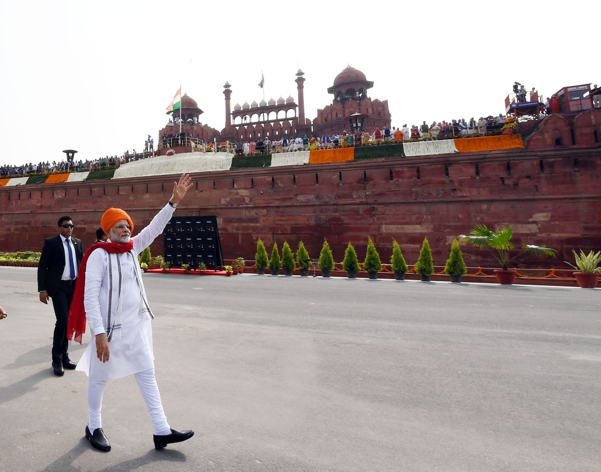 Indian Prime Minister Narendra Modi waves to the crowd at the Red Fort in New Delhi prior to the Independence Day ceremony. Photo coutesy: Twitter/@narendramodi