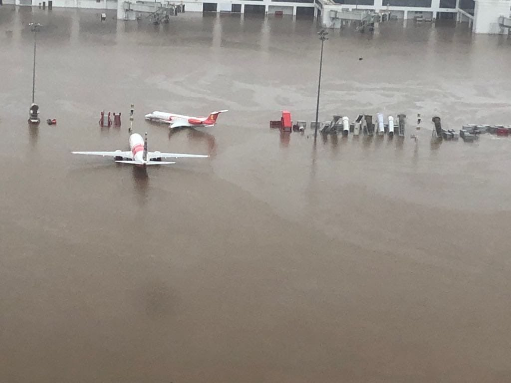 The flood has disrupted air, rail and road traffic in several places., with the Kochi Airport inundated.