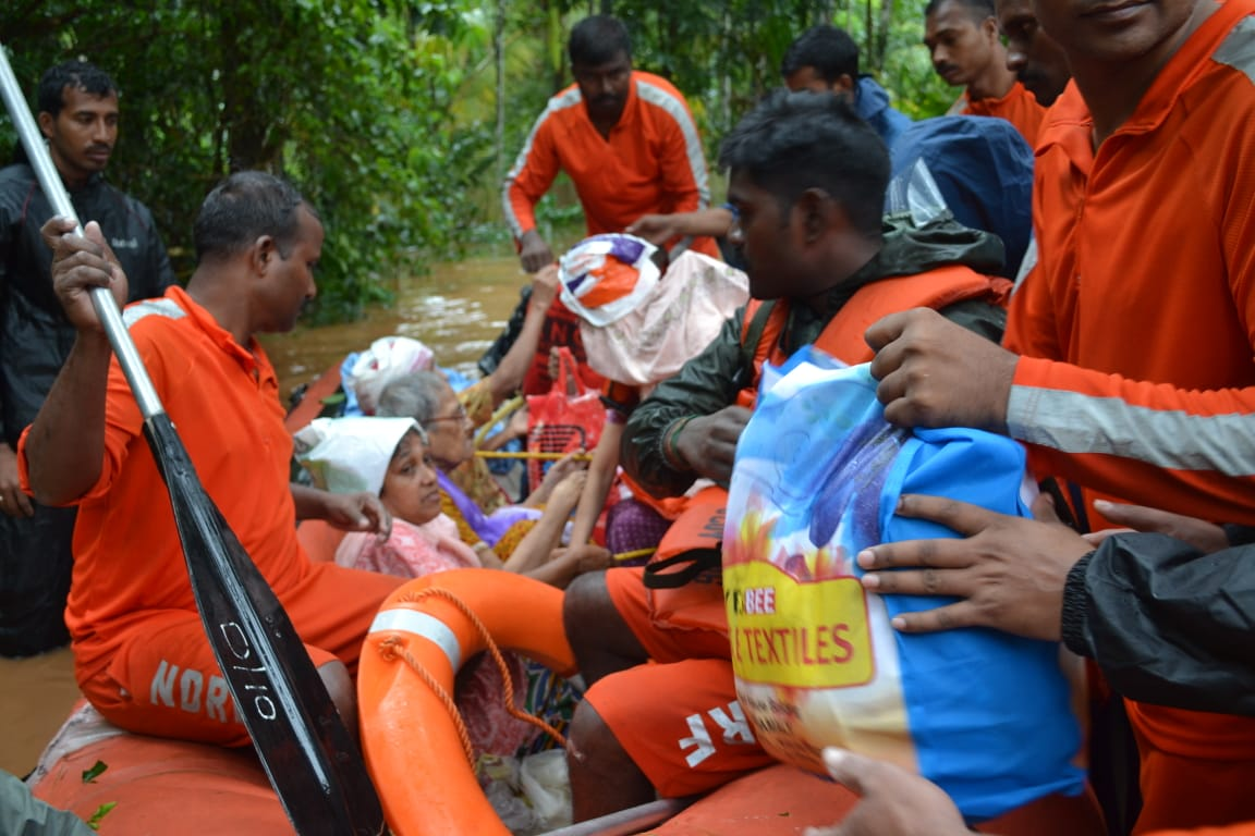 National Disaster Response Force (NDRF) rescuers evacuating people to safer places in Kerala. It is a multi-disciplinary,high-tech specialist force with 12 battalions trained to respond to disasters. Photo courtesy: Twitter/@NDRFHQ