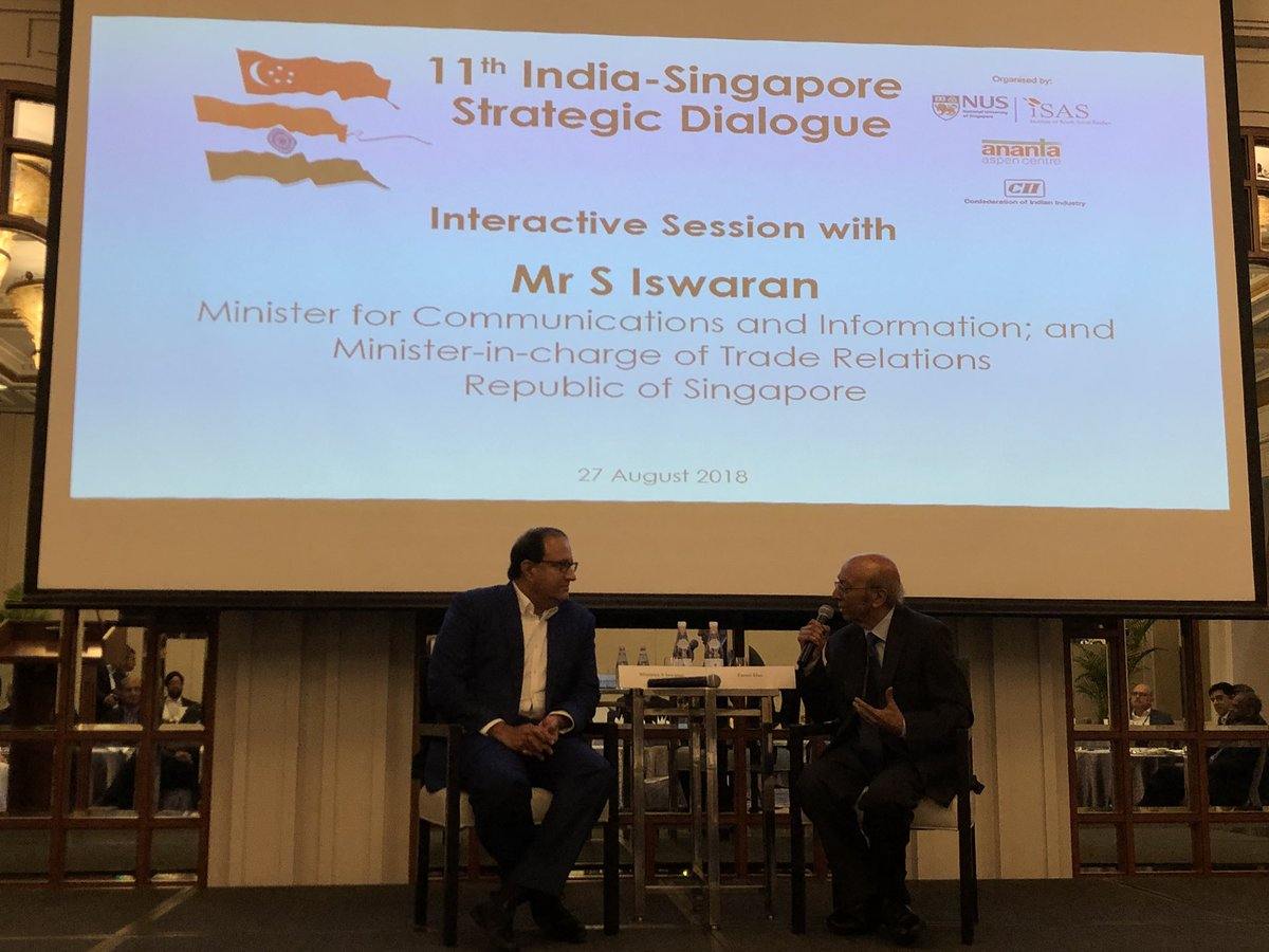 Singapore Minister for Commerce and Information S Iswaran (left) with Tarun Das, Chairman, IEG, conversing about deepening India-Singapore economic and trade relations over the next decade at the 11th India-Singapore Strategic Dialogue. Photo courtesy: Twitter/@jawedashraf5