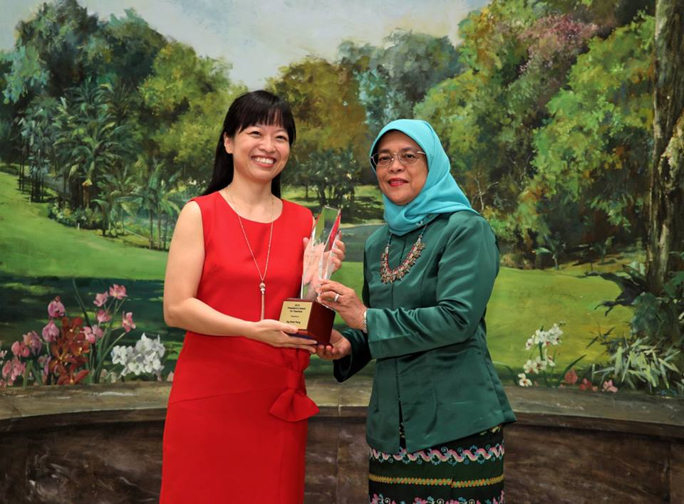 President of Singapore Halimah Yacob presenting President's Award for Teacher (PAT) to Ng Sheh Feng. Photo courtesy: Facebook page of Halimah Yacob
