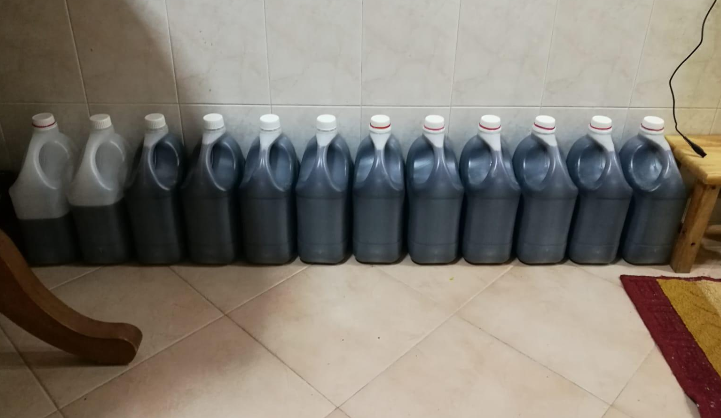 HSA authorities seized stocks of prepared cough syrup stored in large plastic containers from the HDB flat. Photo courtesy: HSA