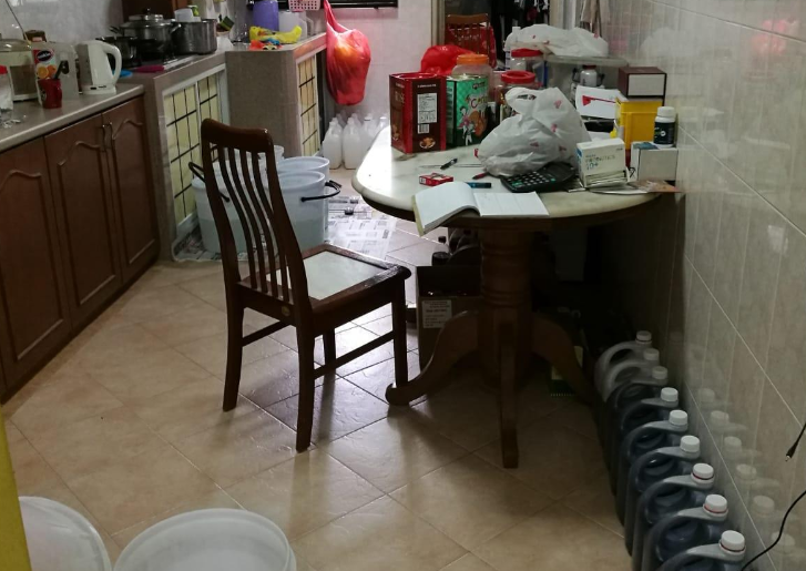 Scene of the kitchen of HDB flat which was used as manufacturing facility for cough syrups. Photo courtesy: HSA