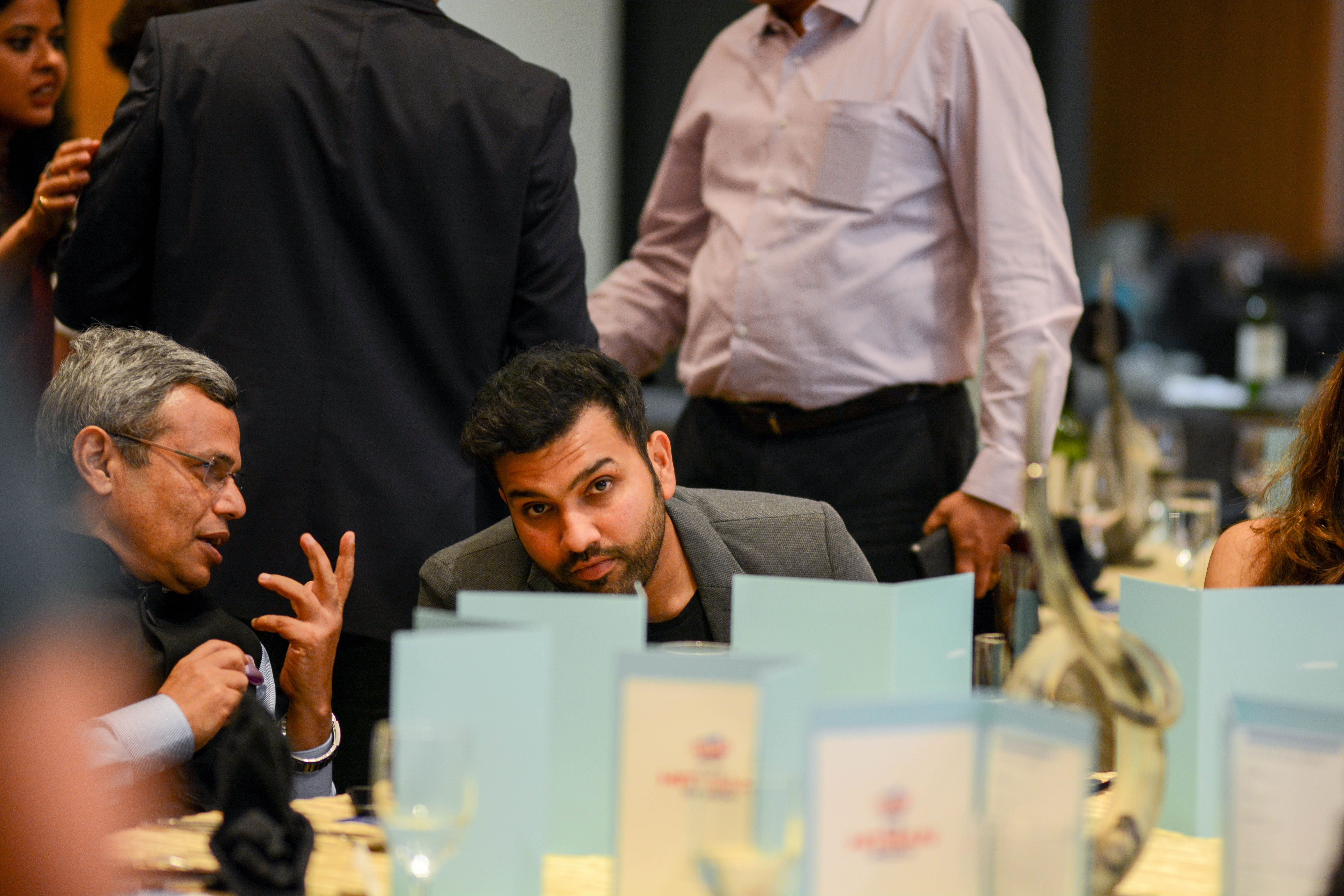 Rohit turns an ear to interact with the high commissioner during dinner. Photo courtesy: Events Kingdom