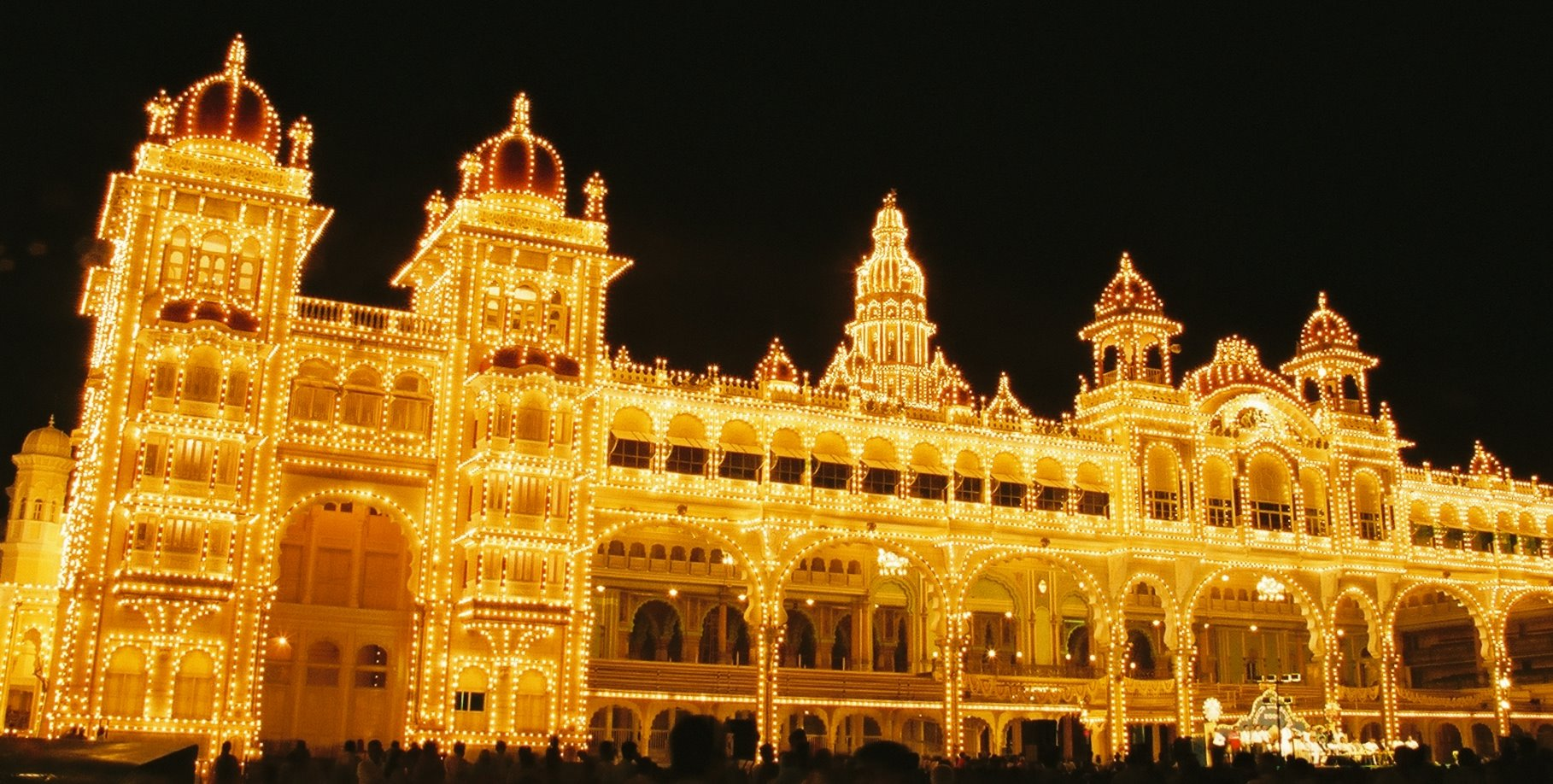 During the entire ten-day celebrations, the Mysuru Palace is lit up decked in colourful lights. Photo courtesy: Wikimedia