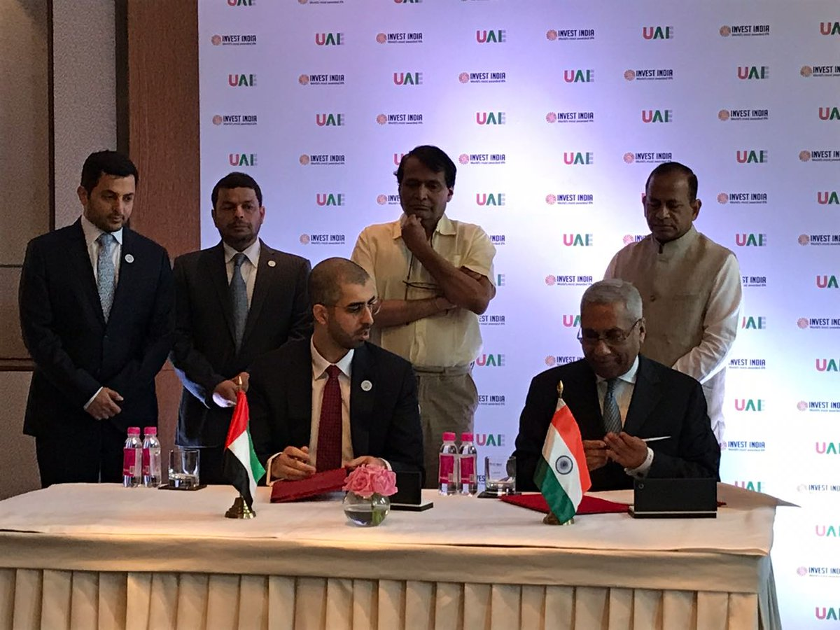 Omar Bin Sultan Al Olama, Minister of Artificial Intelligence, UAE, and Deepak Bagla, MD and CEO, Invest India, sign an MoU on Blockchain, AI and Analytics to improve overall governance through convergence (Photo courtesy: Invest India