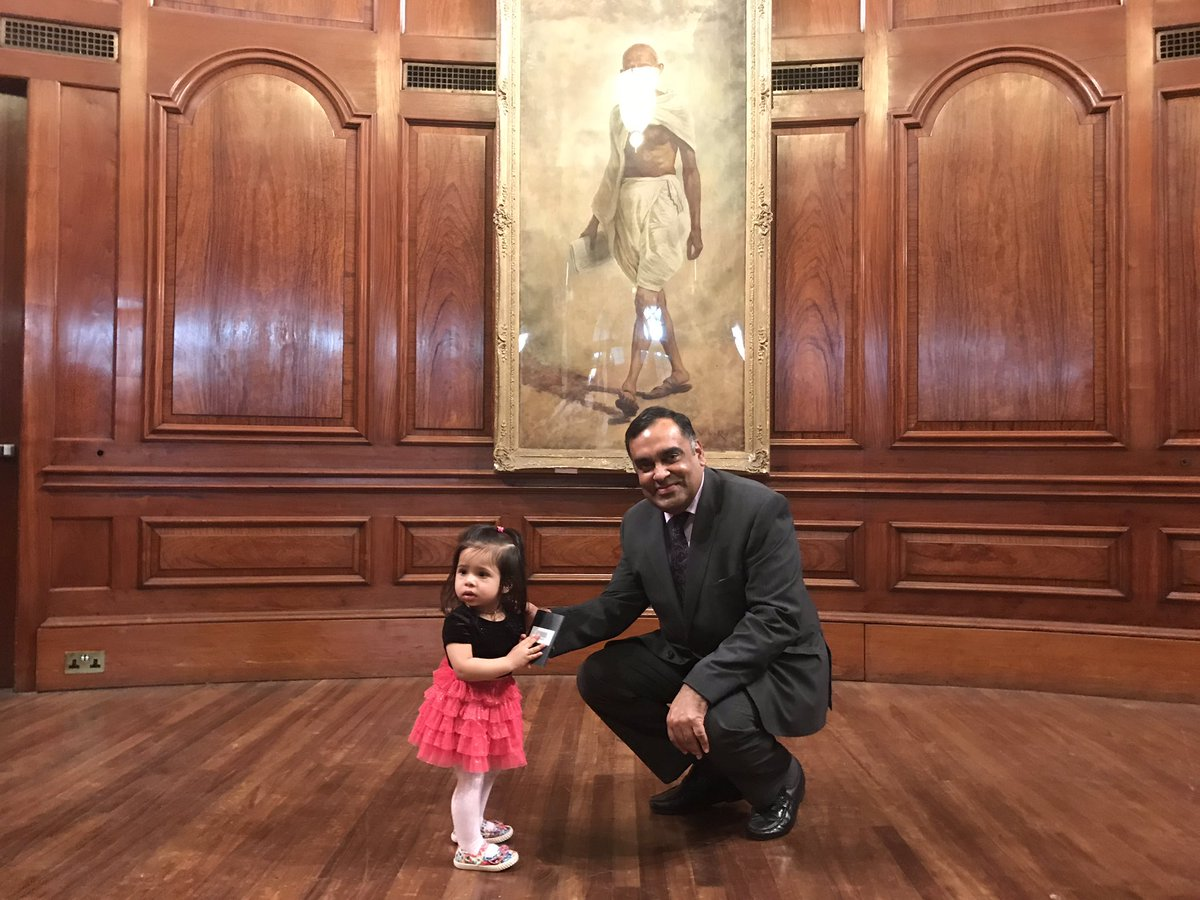 Forteen month old Darlene Fernandes looks askance after Indian High Commissioner to UK Y K Sinha presents her with passport (Photo courtesy: High Commission of India, London