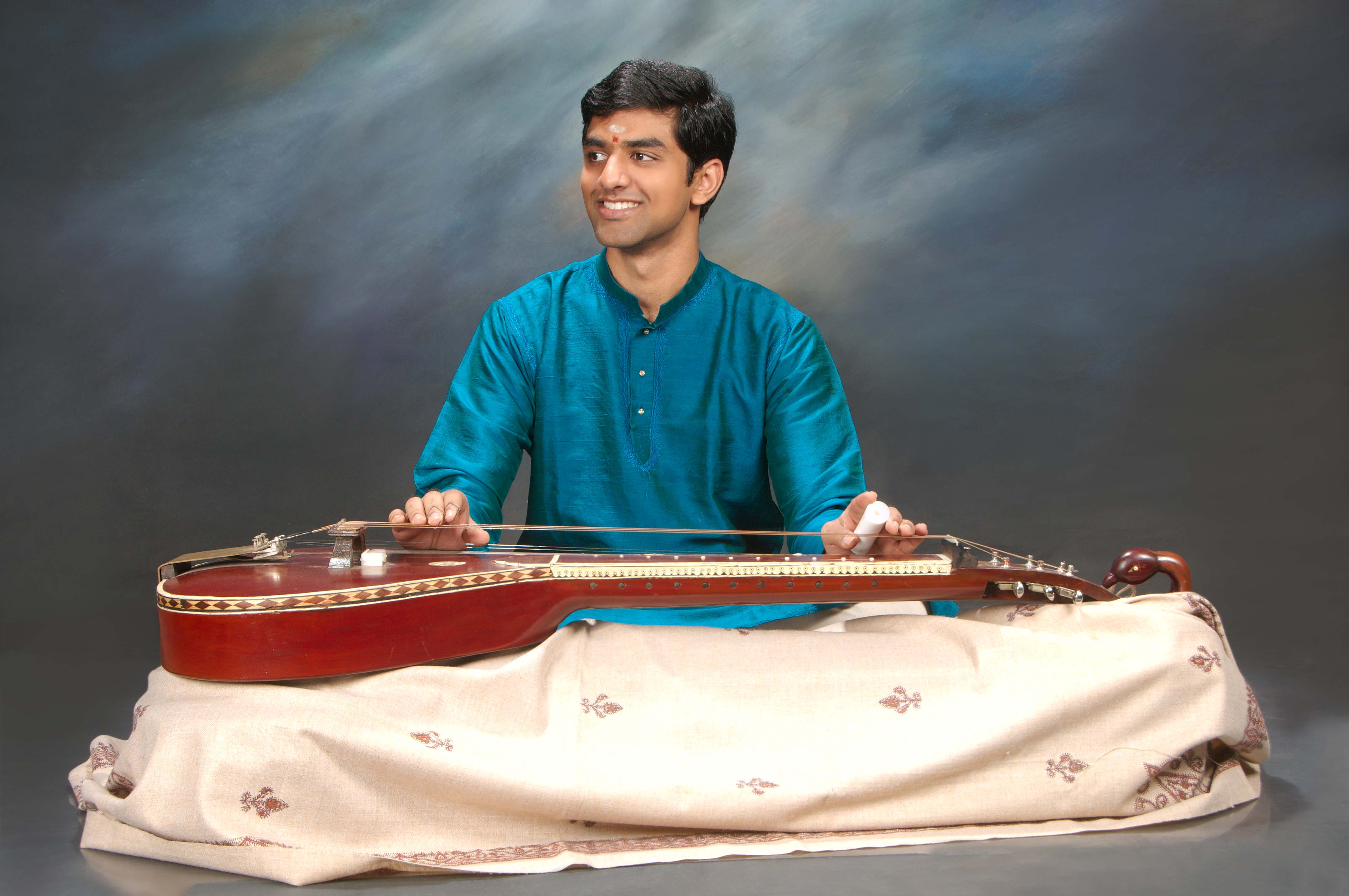 It is a unique experience to watch Vishaal Sapuram as his nimble fingers strum and glide across the fretless strings of chitravina. Photo courtesy: Esplanade Theatres on the Bay