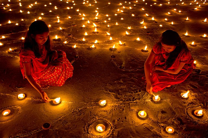 Deepavali is a five-day celebration, wherein friends and families get together, light 'Diyas' or earthen lamps in their houses, feast on sweet delicacies, exchange gifts, play games and set off firecrackers. Photo courtesy: Wikimedia