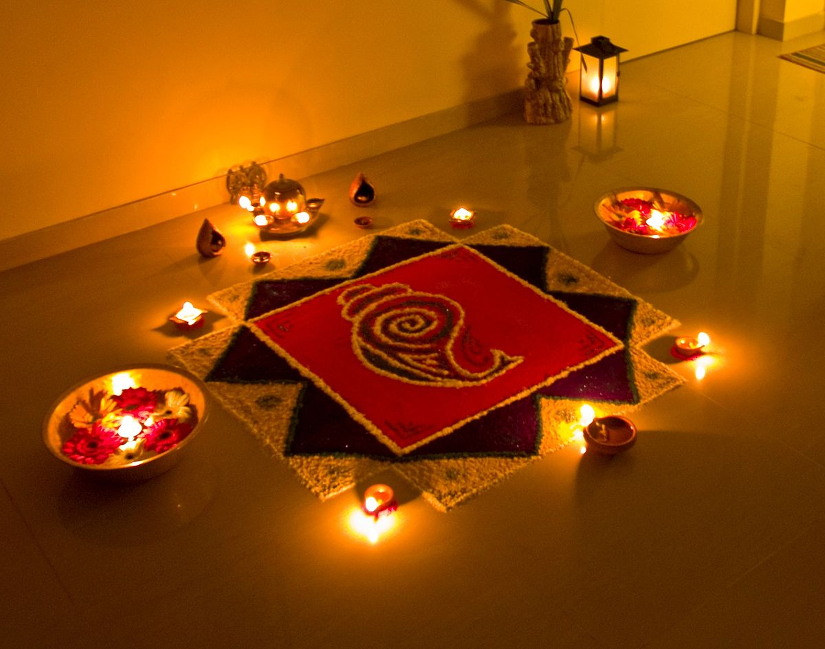 Rangoli is a special feature of Deepavali when patterns are created on the floor or the ground using materials such as colored rice, dry flour, colored sand or flower petals. Photo courtesy: Wikimedia
