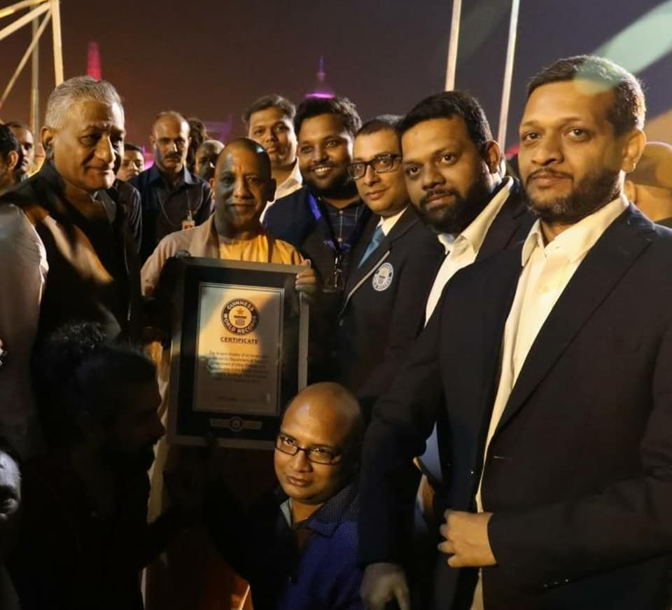 Chief Minister of Uttar Pradesh Yogi Adityanath holding the certificate of Guinness Book of World Records at Ayodhya. Photo courtesy: Facebook page of UP Tourism
