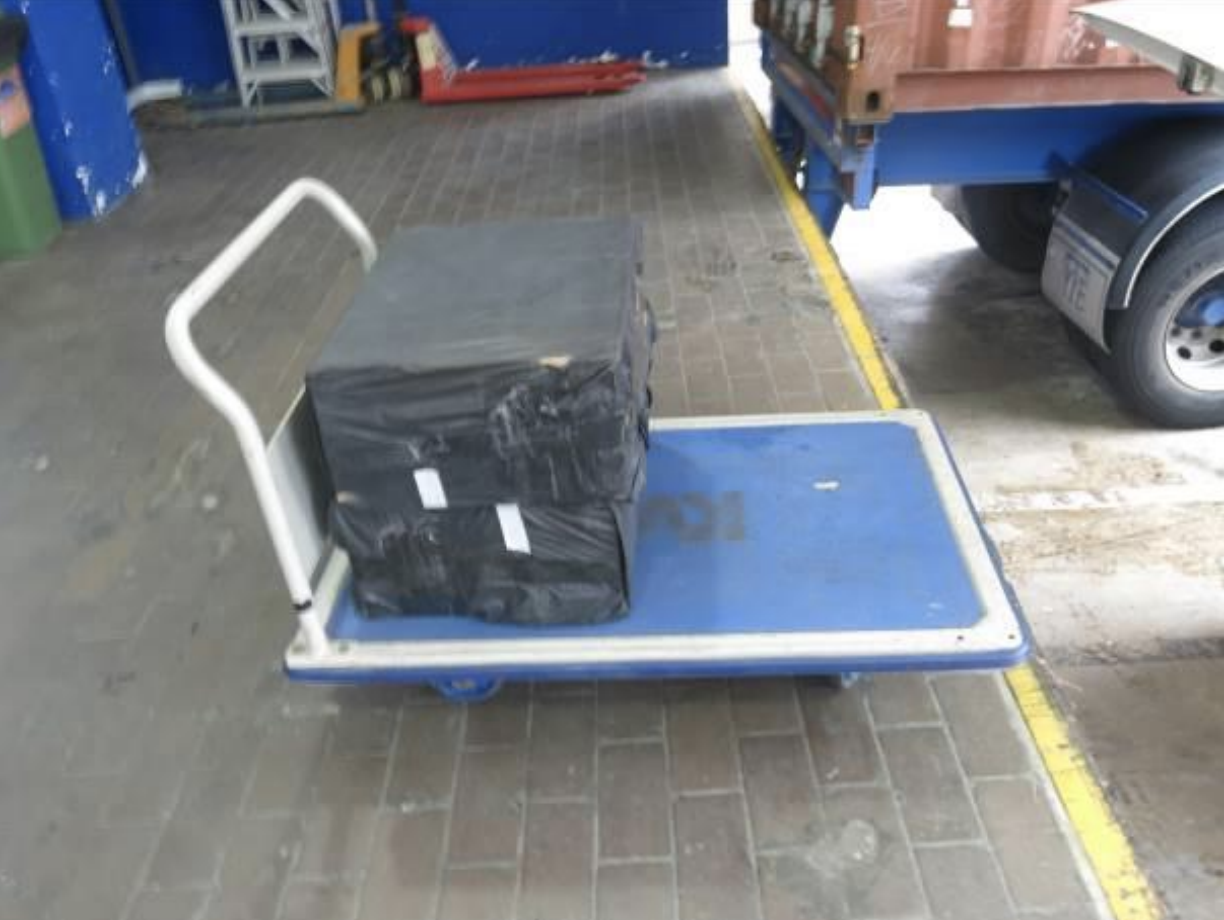During the raid of a self-storage facility in Kallang Sector, Singapore Customs officers saw a man pushing a trolley loaded with what appeared to be boxes wrapped in black trash bags to the loading bay of the building. Photo courtesy: Singapore Customs