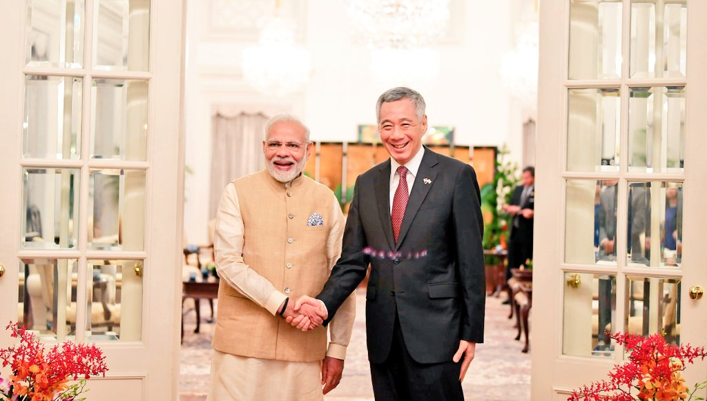 Indian Prime Minister Narendra Modi shares a close bonhomie with Singaporean Prime Minister Lee Hsien Loong. Photo courtesy: Twitter/@MEAIndia