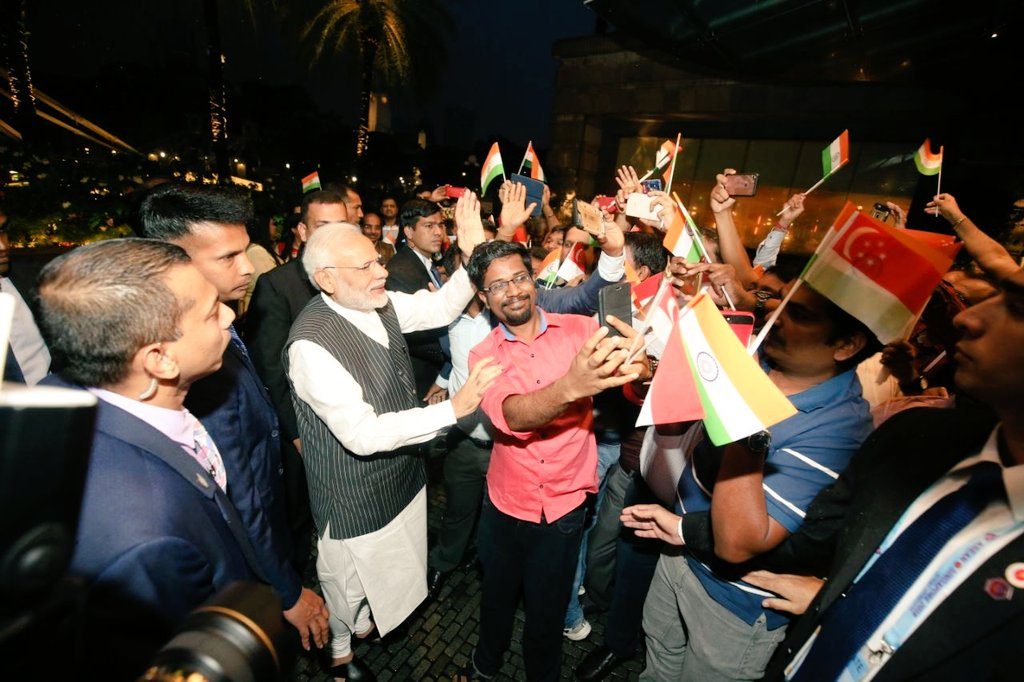 Members of Indian diaspora accorded a huge welcome to Indian Prime Minister Narendra Modi on his arrival in Singapore. Photo courtesy: Twitter@/MEAIndia