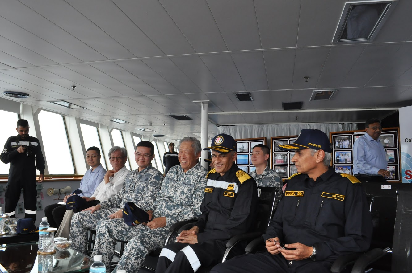 Minister for Defence Dr Ng Eng Hen (centre) being briefed on the combined missile firing by the Republic of Singapore Navy and Indian Navy (IN) on board IN's Deepak-class tanker, INS Shakti, during the 25th Singapore-India Maritime Bilateral Exercise. Photo courtesy: Mindef