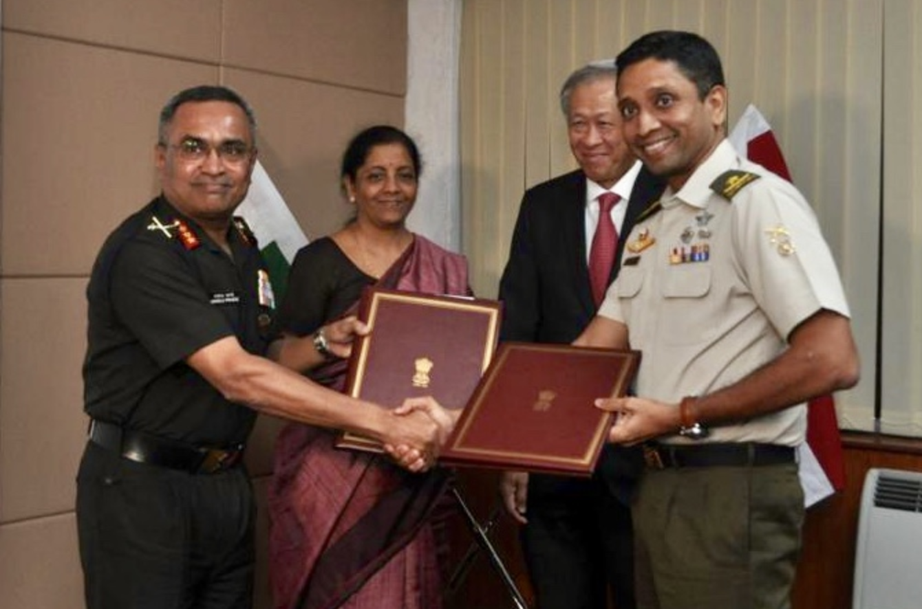 Dr Ng and Ms Sitharaman witnessing the exchange of the renewed Army Bilateral Agreement between Singapore's Commander 2nd People's Defence Force/Island Defence Task Force, Brigadier-General Dinesh Vasu Dash (right) and India's Chief of Staff, Army Southern Command, Lieutenant General Manoj Pande (left). Photo courtesy: Mindef